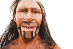 Realistic prehistoric early man neanderthal reproduction portrait closeup.  royalty free stock image