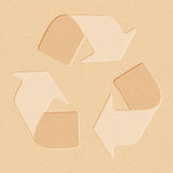 Realistic recycled paper with recycling symbol Royalty Free Stock Photos