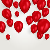 Realistic red birthday balloons flying for party or celebrations. Space for message. Isolated on light background. Stock Images