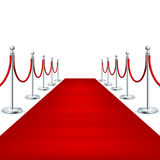 Realistic Red carpet between rope barriers. EPS 10 Stock Image