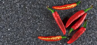 Realistic Red Hot Chilli Peppers. 3D Rendering Of Realistic Red Hot Chilli Peppers Top View On Granite Surface vector illustration