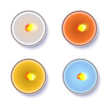 Realistic round candles in a metal case isolated on white backdrop. Stock Images