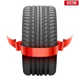 Realistic rubber tire symbol with red ribbon. Royalty Free Stock Photos