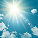 Realistic shining sun with lens flare. Blue sky with clouds background. Vector illustration Royalty Free Stock Image