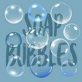 Realistic soap bubble on blue background with text. vector soap bubble illustration. Soap Bubble set. Vector. Realistic soap bubble with rainbow colors on blue Royalty Free Stock Images