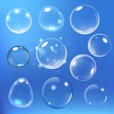 Realistic soap bubble on blue background. vector soap bubble illustration. Soap Bubble set. Vector illustration. Realistic soap bubble with rainbow colors on Royalty Free Stock Photos