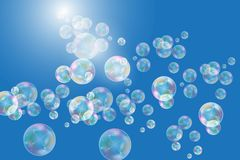 Realistic soap bubbles with rainbow reflection set isolated on the blue background. Vector Illustration stock illustration