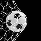 Realistic soccer ball or football ball in net on black background. 3d Style vector Ball. Realistic soccer ball or football ball in net on black background. 3d Royalty Free Stock Photography
