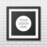 Realistic square black frame  on the brick wall Royalty Free Stock Photos