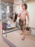 Realistic statue of a prehistoric boy in the Museum of Science i Stock Photography