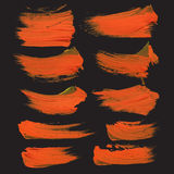 Realistic strokes drawn thick orange paint on black pap Royalty Free Stock Photography