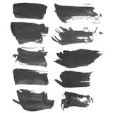 Realistic strokes painted with black liquid paint Royalty Free Stock Photography