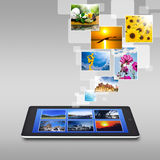 Realistic tablet pc computer with blank screen. Tablet with content flying past Stock Image