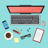 Realistic technology workplace organization. Top view of color work desk with laptop, smartphone, tablet pc, diary Royalty Free Stock Photos