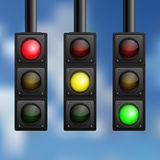 Realistic traffic lights on sky background Stock Photo