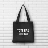Realistic vector black textile tote bag. Closeup on brick wall background  Royalty Free Stock Photography