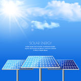 Realistic vector illustration of solar batteries on cloudscape blue background.  Stock Images