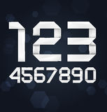 Realistic Vector Paper Digits. On dark background Stock Photos