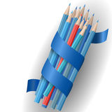Realistic vector pencils. Single red pencil stands out amongst many blue pencils. School supplies concept. Vector illustration Stock Photos