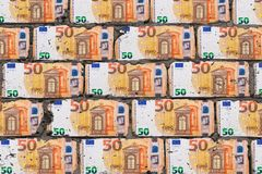 Realistic wall of blocks in form of fifty euro. Bricks from money art concept. Realistic wall of blocks in the form of fifty euro. Bricks from money art concept stock photography