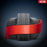 Realistic wheels and tire concept with ribbon. Royalty Free Stock Image