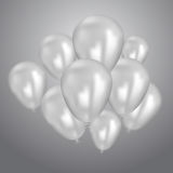 Realistic white birthday balloons flying for party or celebrations. Space for message. Isolated on light background. Stock Photos