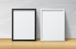 Realistic White and Black Blank Picture frame. Standing on Light Wood Floor at Royalty Free Stock Images