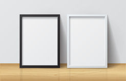 Realistic White and Black Blank Picture frame, standing on Light Royalty Free Stock Photos