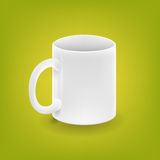 Realistic white cup on green background Stock Photo