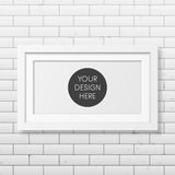 Realistic white frame on the brick wall background Stock Photo