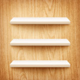 Realistic white shelves on wooden wall Stock Photography
