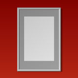Realistic White vertical frame for paintings. Realistic White vertical frame with passe-partout for paintings or photographs hanging on the wall. On a red Royalty Free Stock Photos