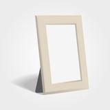 Realistic woden picture or photo frame mock up standing on light background. Stock Photos