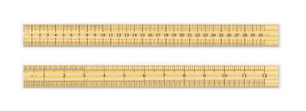 A realistic wooden ruler of 30 cm and 12 inches royalty free illustration