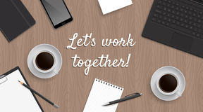 Realistic workplace table with quote 'Let's work together' Stock Image
