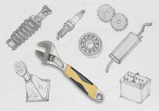 Realistic yellow wrench on a concrete wall among drawing auto parts Royalty Free Stock Images