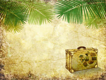 Realistik image of palm trees and a suitcase on the backdrop of the ancient wall Stock Photography