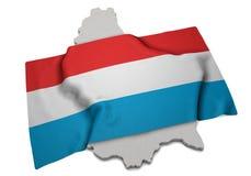 Realistische Flagge, welche die Form von Luxemburg (Reihen, umfasst) Lizenzfreie Stockfotos