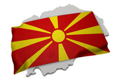 Realistische Flagge, welche die Form von Mazedonien (Reihen, umfasst) Stockbilder