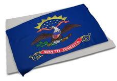 Realistische Flagge, welche die Form von North Dakota (Reihen, umfasst) Lizenzfreie Stockfotos