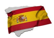 Realistische Flagge, welche die Form von Spanien (Reihen, umfasst) Stockbild