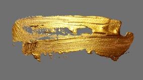 Realistische Hand, die goldene Bürstenanschlag-Farbenstelle zeichnet Lizenzfreie Stockbilder