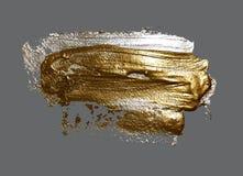 Realistische Hand, die goldene Bürstenanschlag-Farbenstelle zeichnet Lizenzfreies Stockbild