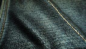 Realistische jeans die in de wind golven Abstracte ultra-HD resolutie als achtergrond De textuur van de close-upstof Naadloze lij stock illustratie