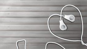 Realistische Kopfh?rer auf einem h?lzernen Hintergrund in Form eines Herzens Gegenstand, zum Musik im Stil des Realismus, Musik 3 stock abbildung