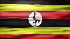 Realistische nahtlose Schleifen-Flagge von Uganda wellenartig bewegend in den Wind mit in hohem Grade ausführlicher Gewebe-Bescha stock footage