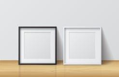 Realistische Witte en Zwarte Lege Vierkante Omlijsting, bevindend o Royalty-vrije Stock Foto
