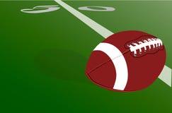 Realistischer amerikanischer Fußball-Ball auf grünem Feld nahe Yard-Line 50 vektor abbildung