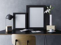 realistisk åtlöje upp av den tomma mallen för affisch två i svart polerad ram i svart hemtrevlig kontorsworkspaceinre i anseende royaltyfri illustrationer
