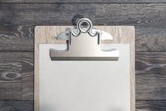 Realistisk skrivplatta med det tomma pappers- arket p? tr?bakgrund framf?rande 3d stock illustrationer